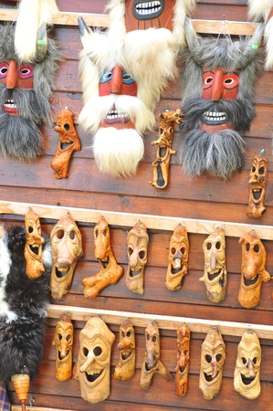 market place: Old traditional masks displayed at the market place in Bran, Brasov, Romania Stock Photo