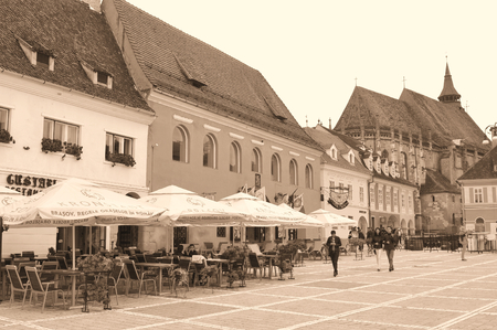 brasov: Brasov, Romania - June 28, 2015: Tourists walk along the cobbled streets of the old town of Brasov in Transylvania, Romania Editorial