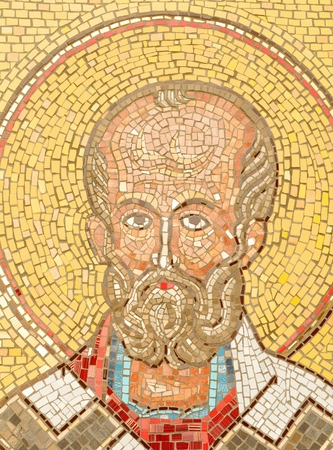 justinian: Brasov, Romania - June 28, 2015: Architectural detail of mosaic depicting Saint Nicholas is exhibited in the central park of Brasov, Romania.