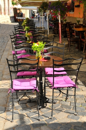 vintage chair: Terrace restaurant on cobbled streets