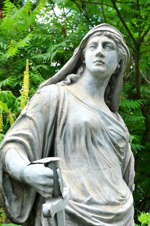depicting: Statue depicting Roman goddess with sword