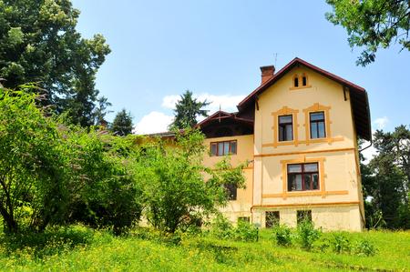 cluj: Cluj Napoca, Romania - July 3, 2015: Old architecture overlooks the botanical garden, major tourist attraction in Cluj Napoca, Transylvania, Romania Editorial