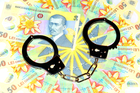 lei: Financial crime concept with Romanian currency lei and handcuffs