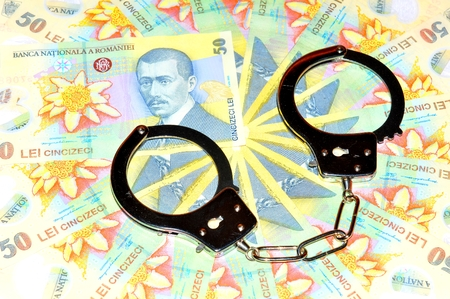 leu: Romanian currency lei and handcuffs Stock Photo
