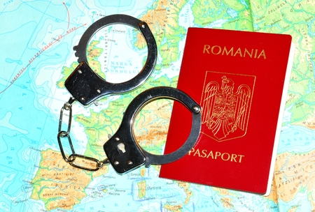leu: Romanian passport with handcuffs on Europe map