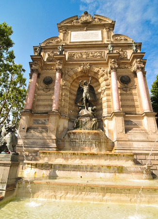 michel: Architectural detail of the Fountain Saint Michel in Paris , France Stock Photo