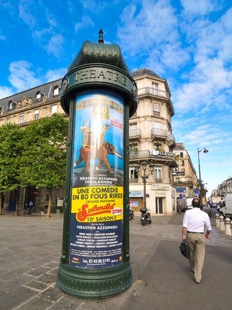 display advertising: Paris, France – July 7, 2015: Detail of traditional news board for spectacles in Paris, France
