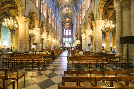 notre dame cathedral: Paris, France - July 7, 2015: Tourists visit the interior of Notre-Dame cathedral, major landmark in Paris, France