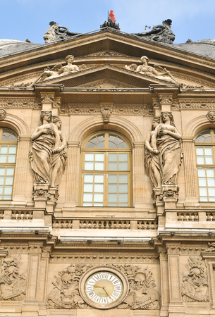 historical building: Paris, France - July 8, 2015: Architectural detail of the Louvre Museum, major landmark in the French capital city and worldwide
