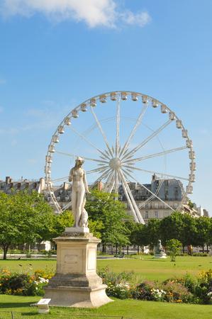 metre: Paris, France - July 8, 2015: Roue de Paris, 60 metre tall ferris wheel, overlooks the Tuileries gardens in Paris, France.