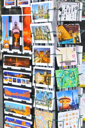concorde: Paris, France - July 8, 2015: Detail of various postcards for sale depicting Parisian landmarks in Place de la Concorde, Paris, France