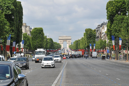 champs elysees: Paris, France - July 8, 2015: French flags overlooks the Champs Elysees boulevard a week before the national holiday in Paris, France
