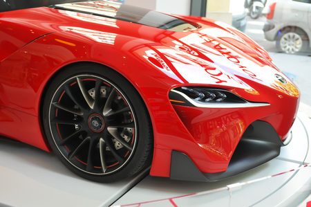 elysees: Paris, France - July 8, 2015: Detail of red Toyota modern car displayed in window shop on Champs Elysees in Paris, France Editorial