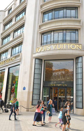 champs elysees: Paris, France - July 8, 2015: Entrance to the Louis Vuitton luxury fashion store on Champs Elysees in central Paris, France