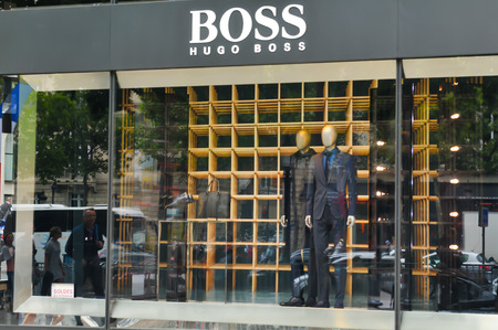 champs elysees: Paris, France - July 9, 2015: Entrance to the Hugo Boss luxury fashion store on Champs Elysees in central Paris, France Editorial