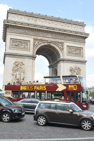 champs elysees: Paris, France - July 9, 2015: Intense traffic around the Triumphal Arch on  Champs Elysees boulevard in Paris, France