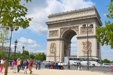 champs elysees: Paris, France - July 9, 2015: Tourists admire the beautiful architecture of the Triumphal Arch on  Champs Elysees boulevard in Paris, France