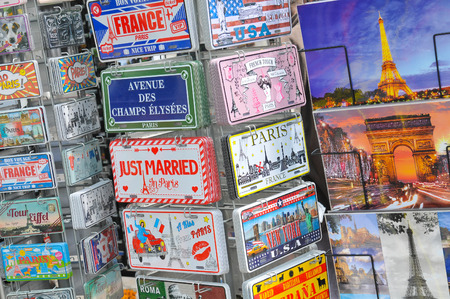 souvenir: Paris, France - July 9, 2015: Detail of various postcards for sale depicting Parisian landmarks in Place de la Concorde, Paris, France Editorial