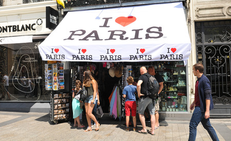 souvenir: Paris, France - July 9, 2015: People pass by souvenir shop on Champs Elysees in central Paris, France