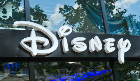 cartoons television: Paris, France - July 9, 2015: Detail of entrance to Disney store on Champs Elysees, Paris, France