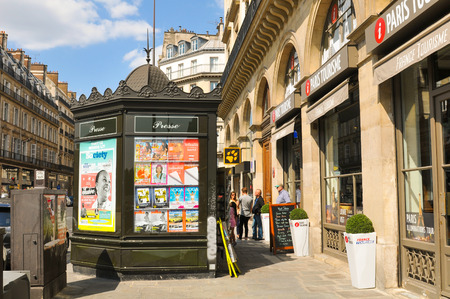 news stand: Paris, France - July 9, 2015: View of street, news stand and touristic centre in Paris, France