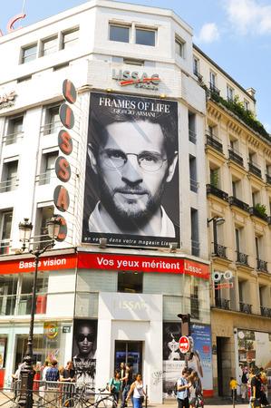 rivoli: Paris, France - July 9, 2015: Advertisement for Frames of Life by Giorgio Armani overlooks Rivoli street in central Paris