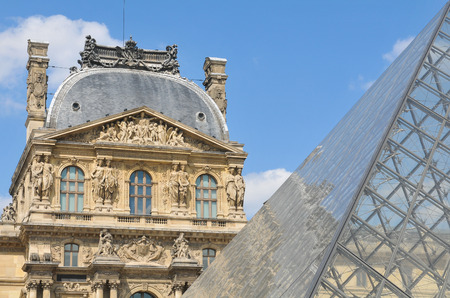 contrast: Paris, France - July 9, 2015: Architectural detail the Louvre Museum, major landmark in the French capital city and worldwide