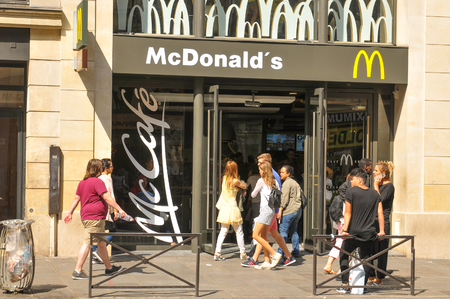 mcdonalds: Paris, France - July 9, 2015: People enter McDonalds fast food restaurant in central Paris