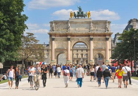 tourists: Paris, France - July 9, 2015: Tourists visit LArc de Triomphe du Carrousel, major attraction in central Paris, France
