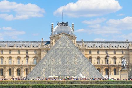 museum visit: Paris, France - July 9, 2015: Tourists visit the famous Louvre Museum, major attraction in central Paris, France Editorial