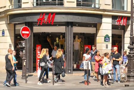 rivoli: Paris, France - July 9, 2015: Shopping centre H  M advertise summer sales in central Paris Editorial