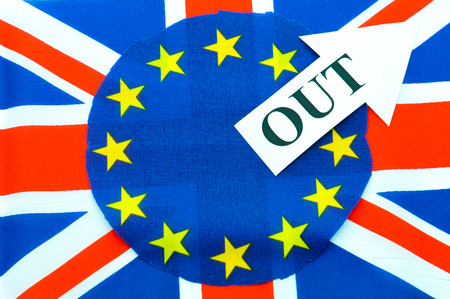the topical: Brexit UK EU referndum concept with flags and topical message