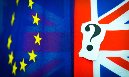 the topical: Brexit UK EU referendum concept with flags and topical message