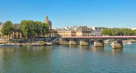 architectural tradition: Paris, France - July 9, 2015: Panorama of Paris with Pont des Arts and the Seine River in summer