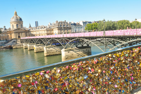 paris france: Paris, France - July 9, 2015: Detail of love locks symbolically fastened to the railings of the Ponts des Arts in Paris. Tying a love lock on to the Pont des Arts before throwing the key into the River Seine beneath has become a tourist tradition in r