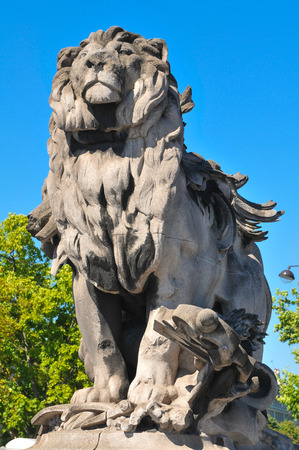 Architectural detail of statue depicting lion in Paris Фото со стока