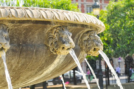 royale: Detail of medieval fountain at Place des Vosges (Place Royale), major landmark in Paris, located in Marais district.
