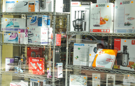 appliances: Paris, France - July 10, 2015: View of electrical appliances on display in shop window in the Marais district of Paris.