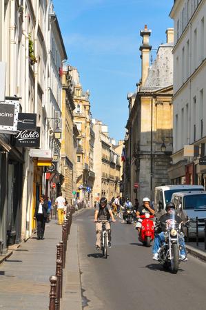 parisian scene: Paris, France - July 10, 2015: View of typical street in the Marais district of Paris, France