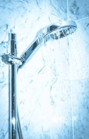 ceiling slab: Detail of modern shower with water pouring Stock Photo
