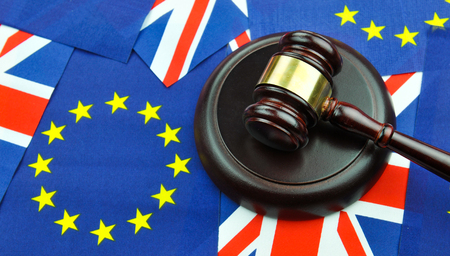 court: Brexit referendum concept with EU and UK flags and gavel