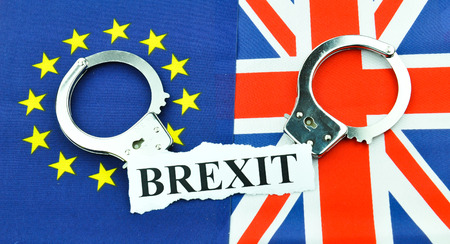 dependance: Brexit referendum concept with EU and UK flags and handcuffs