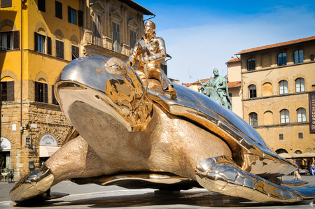 "Florence, Italy - June 25, 2016: Modern sculpture entitled ""Searching for Utopia"" is displayed in Piazza della Signoria in Forence, Italy as part of ""Spiritual Guards"", an exhibit by Belgian artist Jan Fabre."