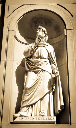 humanist: Architectural detail of statue depicting Francesco Petrarca in Florence, Italy.