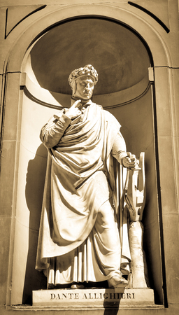 humanist: Architectural detail of statue depicting Dante Allighieri in Florence, Italy.