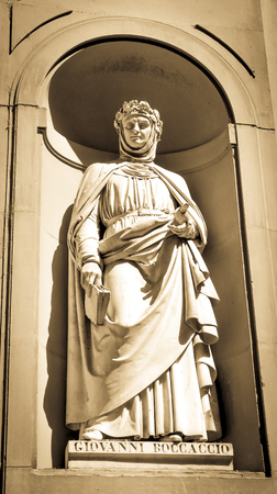 humanist: Architectural detail of statue depicting Giovanni Boccaccio in Florence, Italy.