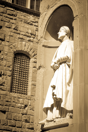 humanist: Architectural detail of statue depicting Andrea Orgagna in Florence, Italy.
