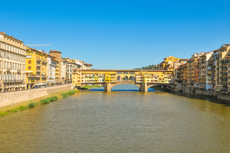 Architecture of Ponte Vecchio overlooking the Arno river in Florence, Italy
