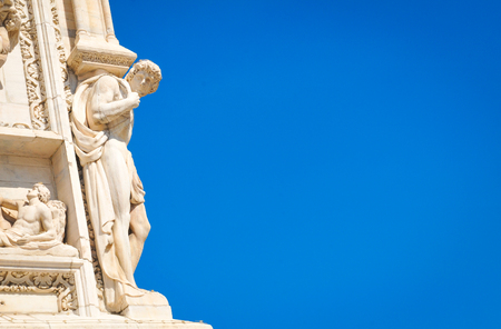 Architectural detail of the famous Milan Cathedral (Duomo di Milano) in Italy. Stock Photo - 80939258