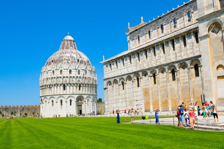 Pisa, Italy - June 25, 2016: Tourists visit the cathedral in the historical town of Pisa, Italy.